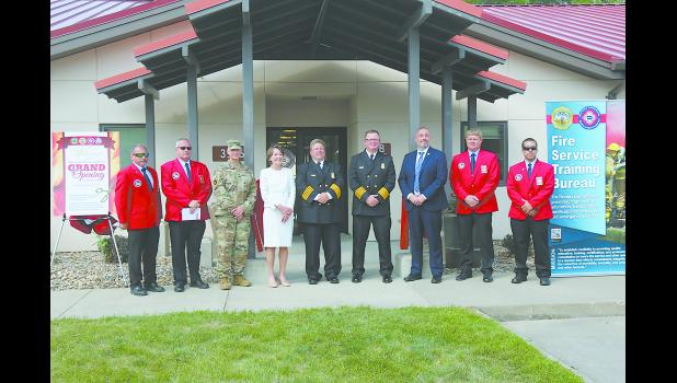 IFA board members attended the Fire Service Training Bureau ribbon cutting and grand opening on Wednesday, August 12, at the new facility on Camp Dodge. Pictured from left to right: IFA Past President Marv Trimble, IFA President Gene Evans, Deputy Adjutant General Stephen Osborn, Johnston Mayor Paula Dierenfeld, FSTB Bureau Chief John Kraemer, State Fire Marshal Dan Wood, IFA 3rd vice-president Chuck Raska and IFA 5th vice-president Aaron Clemons.
