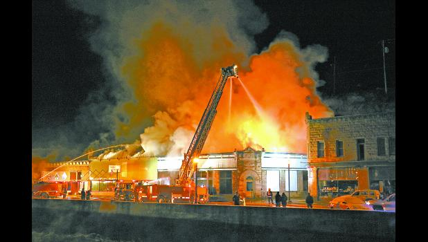 A ladder truck sprays water onto the burning roof of The Vault building in downtown Hot Springs at around 10:30 p.m. on Monday, Feb. 17. See more photos and story inside this issue. Photo by Brett Nachtigall, Publisher of the Fall River County Herald-Star.