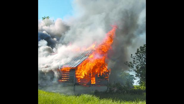 Members of the Rockwell Community Fire Department along with Swaledale Fire conducted a controlled training burn recently. Photo submitted by Josh Dannen.