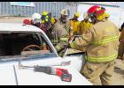 The extrication class at the Agra fire school works on a car.