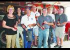 LODD Team members are pictured with Loretta McDowell Miletta Vista Winery holding Heroes series wine. Pictured from left to right are: Loretta McDowell, Roseanne Scurto, Ron Tubbs, Terry Zwiebel, Toby Watts, Fred Benzel, Casey Ryan and Mikey Eytcheson.